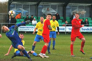 Melton Town FC in action earlier this year at their sports village stadium - Saturday will see a crowd of around 300 and live coverage on BT Sport for an FA Cup clash with Cleethorpes'''Caption:'Michael Reeve and Town could have had more goals were it not for an inspired display from Buckby keeper Bodycote back in March EMN-190820-113153001