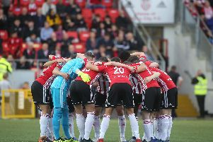 Derry City players pictured in a huddle prior to Friday night's pulsating FAI Cup tie against Dundalk at Brandywell.