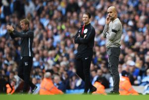 Pep Guardiola watches on as City enjoyed a comfortable win against Brighton (getty)