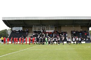 The players line up ahead of Corby Town's clash with AFC Dunstable