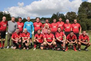 The Manchester United team with Jo Nesbit, the director of the event