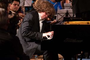 Roman Kosyakov plays with Hastings Philharmonic Orchestra. Photograph by Peter Mould