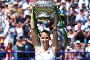 Karolina Pliskova of Czech Republic celebrates with the cup after winning the women's singles final against Angelique Kerber of Germany during day six of the Nature Valley International at Devonshire Park on June 29, 2019 in Eastbourne, United Kingdom. (Photo by Charlie Crowhurst/Getty Images for LTA)