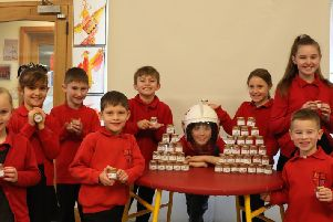 Pupils from St Thomas C of E Primary School in Winchelsea raising funds for the RNLI with Betty's 5p pots SUS-200213-132354001