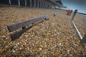 Shingle from Marina Beach covering the promanade, St Leonards, after the recent high winds. SUS-200216-104256001