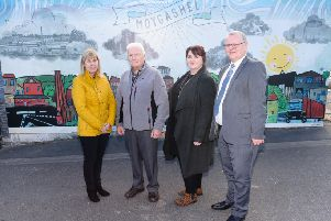 Fiona Stewart, artist; Victor McNickle, Moygashel Residents Group; Phyllis McWilliams, Principal, Howard Primary School and Michael Dallat, Mid Ulster Area Manager, NIHE.