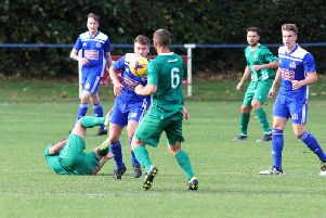 Action from the goalless draw between Thrapston Town and Blackstones in UCL Division One. Pictures by Alison Bagley