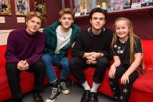 EDITORIAL USE ONLY'Dotty, aged 10 from Lancashire, winner of the Institution of Engineering and Technology's 'Lights, Camera, Action!' competition, helps create pop band New Hope Club's new music video, London. PRESS ASSOCIATION Photo. Issue date: Friday December 7, 2018. The competition, created in partnership with Blue Peter, aims to highlight the diverse careers there are in the engineering sector. The video will be aired on the BBC's Blue Peter on December 6th.  Photo credit should read: Matt Crossick/PA Wire