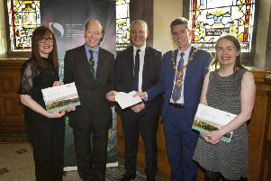 """CLIMATE CHANGE. . . . .Edward Montgomery, The Honourable The Irish Society pictured at the Guildhall on Tuesday morning handing over a cheque for sponsorship of Derry City and Strabane District Council�""""s Green Infrastructure and Climate Change Conference. Receiving the cheque is Mayor, Councillor John Boyle, and from left, Cathy Burns, Climate Programme Manager, DCSDC, John Kelpie, Chief Executive Officer, DCSDC and Dr. Christine Doherty, Lead, Green Infrastructure, DCSDC. (Photos: Jim McCafferty Photography)"""