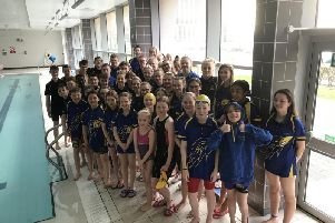Corby Swimming Club members pose for the camera during a break in the Long Course Open Meet