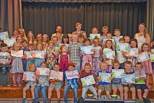 Some of the many young swimmers with their distance certificates, ranging from five metres to 2,000 metres