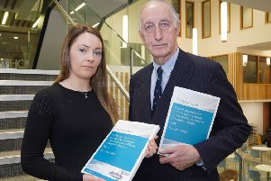 John Gillen with the preliminary draft of his report alongside Dr Eithne Dowds from Queen's University Belfast, one of the contributors to the review process, who describes herself as a lecturer interested in feminism and consent