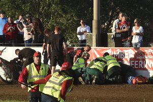 Medics attend to Josh Bates of Panthers after his heat two crash in the meeting with Belle Vue. Photo: David Lowndes.