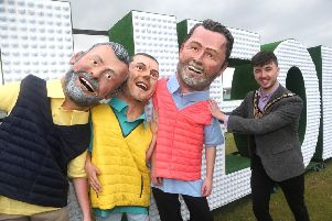 Mayor Sean Bateson with teh big heads at the Live at The 148th Open held in Portrush