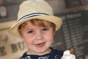 Two-year-old George Davies enjoys an ice cream as Melton swelters today in temperatures hitting the mid-30s EMN-190725-145815001