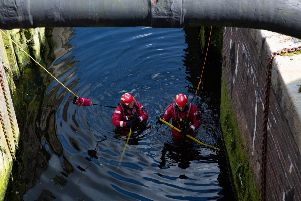 Police and Fire Services search lock after reports of a body in the river. BCH Drones costing �25,000 were used in the search. The Drones carry both optical and thermal imaging devices. Stanground Lock, Peterborough Tuesday 13 August 2019.  Picture by Terry Harris. THA