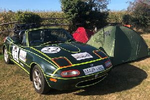 The Mazda and the tent.