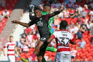 Ivan Toney of Peterborough United challenges for the ball at Doncaster. Photo: Joe Dent/theposh.com.