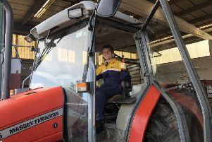 Em in her tractor.