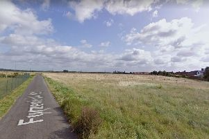 The site plot is to the east of the railway line and Furzenhall Road would cut through it diagonally.