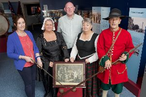 Roisin Doherty, curator, Museum Services, DCSDC, handing over a number of items from the 17th century which will go on display at the Siege Museum. Included are Billy Moore, Siege Museum, Norman Rosborough, Donna Best and Valerie Moore (all in period costume).  (Photo - Tom Heaney, nwpresspics)