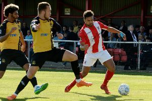 Brackley Town's Luke Fairlamb takes on the Southport defence at St James Park