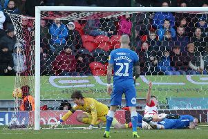 Conor O'Malley of Peterborough United can't prevent Doncaster Rovers from equalising with a Ben White own goal. Photo: Joe Dent/theposh.com