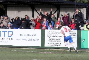 Tom Lorraine heads off to celebrate after he scored the only goal of the game in AFC Rushden & Diamonds' win over King's Lynn Town at Hayden Road. Pictures by Alison Bagley