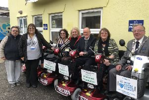 Littlehampton MP Nick Gibb with, from left, Debbie Fletcher, Marion Court, Littlehampton Shopmobility manager June Caffyn, Littlehampton Shopmobility chairman and  Arun councillor Vicky Rhodes, Teresa Poland and Arun District Council chairmn Alan Gammon