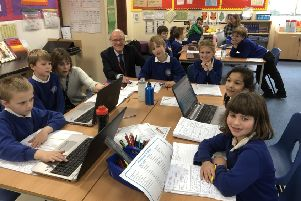Nick Gibb pictured with Headteacher Mrs Sarah Titley and pupils taking part in the Prince William Award Scheme