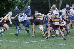Jack Lewis on the run for the Lions against Huddersfield. Picture: Mick Sutterby