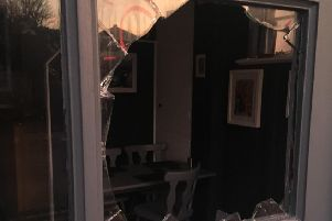 A window was smashed at Nanny Lils café, in Bexhill. Picture: Liza Davidson