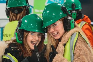The Regis School students Poppy Wallis and Sophie Reeves in Year 9 during the Green Teams recent visit to Ford recycling Plant before they deliver assemblies to the whole school next month. SUS-190222-115753001