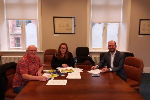 "Sinn F�in Councillor and Irish language spokesperson Kevin Campbell ,along with Councillor Sharon Duddy meeting the Council's Irish language officer P�l "" Frighhil this week."