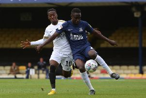 Siriki Dembele (white shirt) in action for Posh against Southend earlier this season.