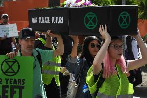 Extinction Rebellion activists in California carried a coffin to call for action on climate change - as Brighton activists will this Sunday (Photo by Mark RALSTON / AFP/Getty Images)