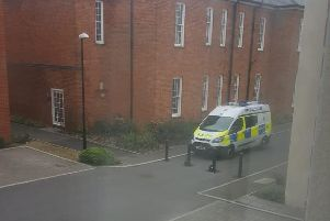 A police van parked on Longley Road.
