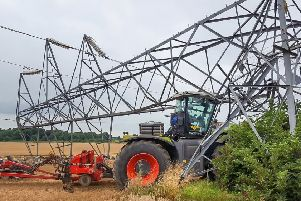 """Fortunately, the driver of this agricultural vehicle escaped unhurt when his'tractor crashed into a pylon while using autosteer near Grantham'�Adam O""""Sullivan-- EMN-190104-151212001"""