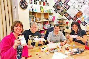 Coastal West Sussex Mind champions decorating some of the mini wellbeing boxes