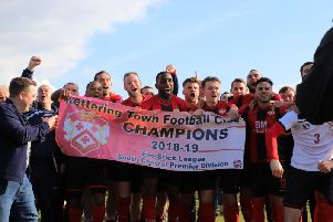 The Kettering Town players celebrate after they clinched the Evo-Stik League South Premier Division Central title with a 1-0 win at Halesowen Town. Pictures by Peter Short