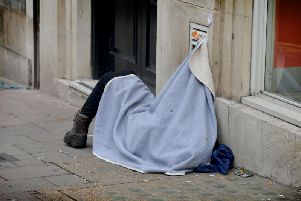 A person sleeping on the street.