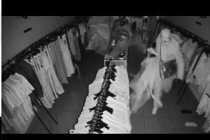 A screenshot of the men as the move through the shop.