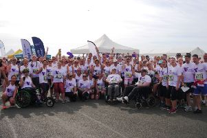 Among the Care for Veterans team for Worthing 10k were supporters in wheelchairs, Mic Riddy, who was self-propelling, and residents Tony Walker and Steve Boylan