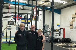 Daz Dugan stands proud at opening with sons Troy and Neo