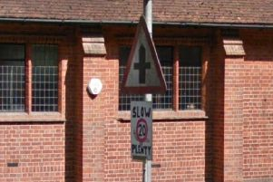A Google Street View image taken in August 2018 shows a makeshift 20mph sign in the road