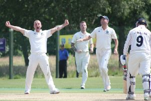 Glendermott's Alan Johnson celebrates the wicket of Ballyspallen's Jamie Millar.