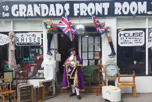 Town crier Jane Smith at the shop