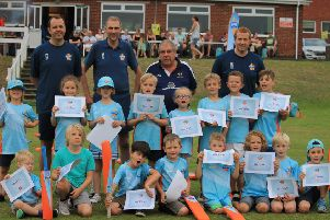 All Stars at Caistor after being presented with their certificates by club chairman Ben Jacob, with coaches Pete Briggs, Andy Blackburn and Jim Parker. Picture: Wes Allison EMN-190729-104942002