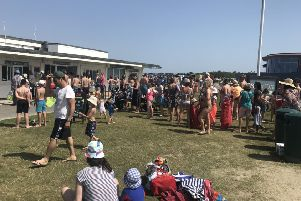 People queueing for ice-cream at West Wittering beach in July