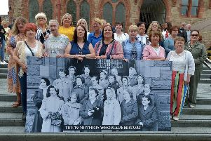 Daughters and grand-daughters, recreate a photo of Springtown Camp mothers who staged a housing protest outside the Guildhall 60 years ago.  DER3119GS-026